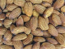 Close up almond nuts background top view. With sea salt Stock Photos