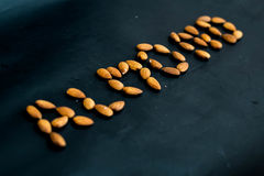 Close up almonds nuts on black background Royalty Free Stock Images