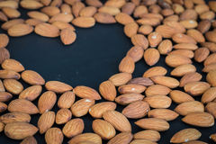 Close up almonds nuts on black background Stock Photo