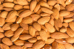 Close-up on Almonds. Over a wooden table stock image