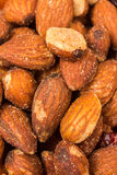 Close up of almonds. Close up of whole salted almond nuts snacks Royalty Free Stock Images