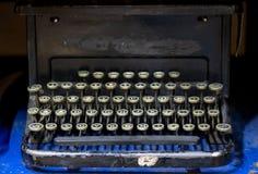 Close up of alphabet keys on a vintage manual typewriter. Close up of keys on a black vintage manual typewriter on a cobalt blue background stock images