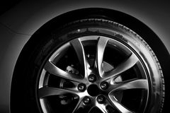 Close-up of aluminium rim of luxury car wheel Royalty Free Stock Photos