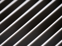 Close-up of aluminum cover grille with pattern of diagonal lines Stock Photography