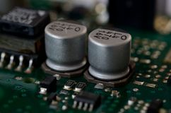 Close up aluminum electrolytic capacitors on PCB Royalty Free Stock Photo