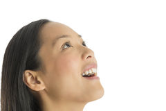 Close-Up Of Amazed Woman Looking Up. Close-up of amazed mid adult woman looking up against white background Royalty Free Stock Photography