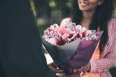 Close up of amazing bouquet of flowers in the hands of young person royalty free stock photos