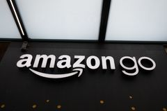 Close up on the Amazon Go store sign at the downtown Seattle Amazon headquarters. Seattle, Washington - June 30, 2018 : Close up on the Amazon Go store sign at stock photo
