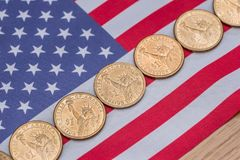 American flag and cent coins, nationalism concept. Close up of american flag and cent coins, nationalism concept royalty free stock images