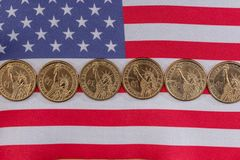American flag and cent coins, nationalism concept. Close up of american flag and cent coins, nationalism concept royalty free stock photo