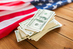 Close up of american flag and dollar cash money Stock Images