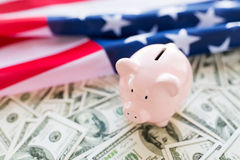 Close up of american flag, piggy bank and money Royalty Free Stock Images