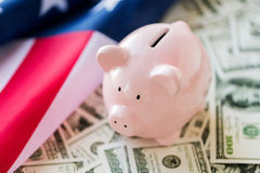 Close up of american flag, piggy bank and money Royalty Free Stock Photography