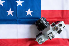 Close-up American flag and retro photo camera Stock Photography