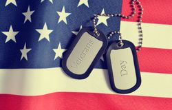 Close up of american flag and soldiers badges. Stock Photos