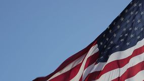 Close up of American flag waving. American Flag Waving. Copy paste on a blue sky background. Close up of American flag waving. Real Flag of the USA slowly stock video