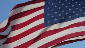 Close up of American flag waving. American Flag Waving. Close up of American flag waving. Real Flag of the USA slowly waving in the wind. Elegant Nylon American stock video footage