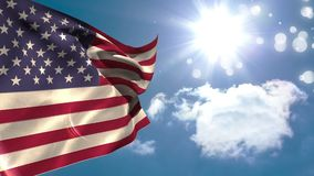 American flag waving. Close up of the american flag waving under the bright sunny sky with bokeh lights stock video footage