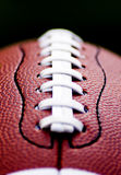 Close up of an american football. Against a black background Royalty Free Stock Images