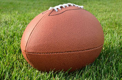 Close up of an American Football on Grass Field Stock Photo