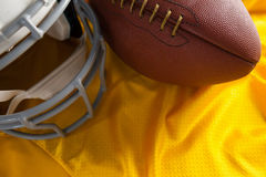 Close up of American football and helmet on jersey Stock Photo