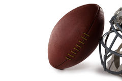Close-up of American Football and helmet. Over white background Stock Images