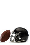 Close-up of American football and helmet. On white background Stock Image
