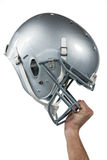Close-up of American football player handing his sliver helmet. On white background Royalty Free Stock Photos