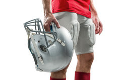 Close-up of American football player in red jersey holding helmet Stock Images