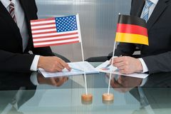 Close-up of american and german businessman Stock Photos