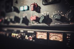 Close-up amplifier equipment with sliders and knobs at boutique recording studio. royalty free stock photography