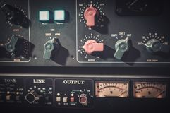 Close-up amplifier equipment with sliders and knobs at boutique recording  studio. Stock Images