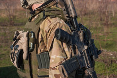 Close up amunition of NATO soldier. Airsoft player in NATO soldier uniform with rifle training in fields royalty free stock photo