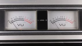Close-up. Analog arrow indicator on the panel. Old analog arrow indicators stereo tape recorder. Macro stock footage
