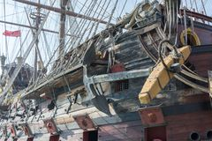 Close Up of the Anchor of an Ancient Pirate Galeon. On Blur Background royalty free stock photo
