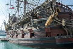 Close Up of the Anchor of an Ancient Pirate Galeon. On Blur Background royalty free stock photos