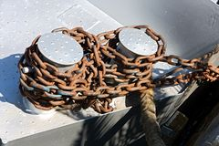 Close up of anchor chain. Thick anchor chain on nautical background royalty free stock images