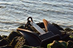 Close up of anchor on rocks Royalty Free Stock Photo
