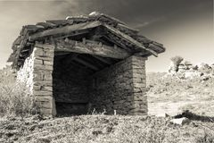 Close up ancient beautiful stone sheep barn in countryside mountains in black and white sepia, basque country, france. Close up ancient beautiful stone sheep Royalty Free Stock Image