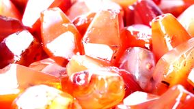 Close up of Ancient Carnelian stone Beads. Ancient site stock video footage