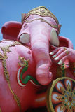 Close-up ancient carving of clining peace Ganesha god, god of successful with blue clear Stock Photography