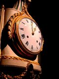 An ancient wall clock. Close-up on an ancient clock stock photography