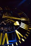 Close-up of ancient dark skeleton clock with golden hands and roman numerals royalty free stock photography