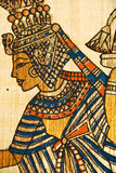 Close up ancient egyptian scroll. Close up of  ancient Egyptian scroll showing a queen painting in golden color Stock Photos