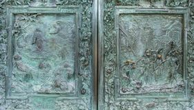 Close up of ancient high relief on metal door,. Pisa, Italy royalty free stock image