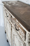 Close-up of ancient white commode bureau furniture with paint peeled off Royalty Free Stock Photo