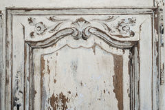 Close-up of ancient white commode bureau furniture with paint peeled off Royalty Free Stock Photos