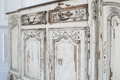 Close-up of ancient white commode bureau furniture with paint peeled off Stock Photos