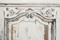 Close-up of ancient white commode bureau furniture with paint peeled off Royalty Free Stock Images