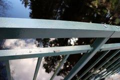 Close up angled photo of a grey steel railing on a bridge. stock photos